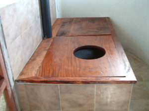 Twin chamber composting toilet. When one chamber is full, the opening is swapped.